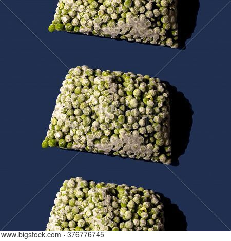 Pattern Of Frozen Green Pea On Blue Background.modern Abstract Food Concept