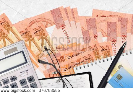 5 Belorussian Rubles Bills And Calculator With Glasses And Pen. Tax Payment Concept Or Investment So