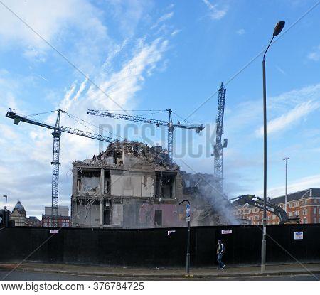 Leeds, United Kingdom - 11 November 2014: Cranes Working On The Demolition Of The Former Milgarth Po