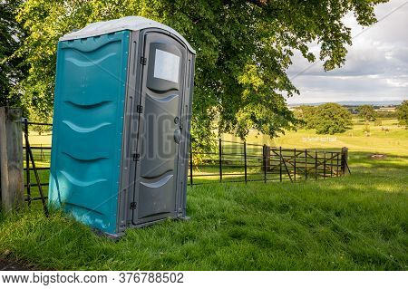 A Plastic Portable Toilet In A Field At An Outdoor Cross Country Horse Trials Event.
