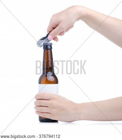 Hand Holding Glass Bottle Of Beer With Opener On White Background Isolation