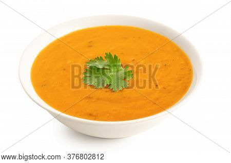 Carrot And Coriander Soup With Fresh Coriander Garnish In A White Ceramic Bowl Isolated On White. Hi