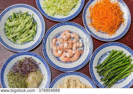 Raw Ingredients For Traditional Asian Cooking On A Wooden Table