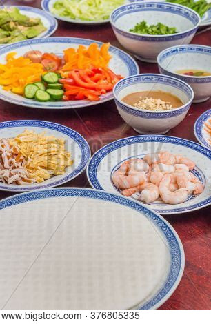 Rice Paper And Ingredients For Making Traditional Vietnamese Spring Rolls