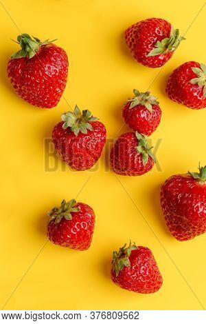 Fresh Delicious Strawberries At Yellow Minimal Background. Top View, Flat Lay, Concept Of Harvesting