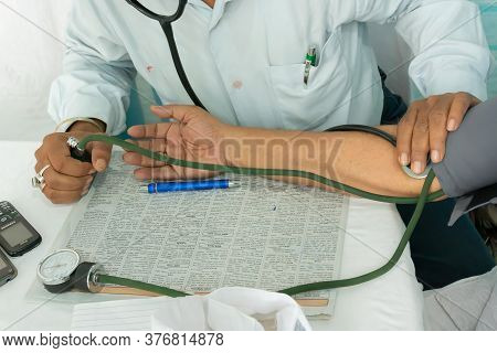 Kolkata, West Bengal, India - 25th February 2018 : Indian Doctor Checking Blood Pressue Of A Patient