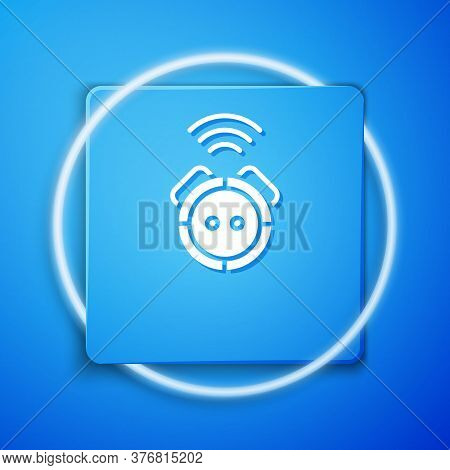 White Robot Vacuum Cleaner Icon Isolated On Blue Background. Home Smart Appliance For Automatic Vacu