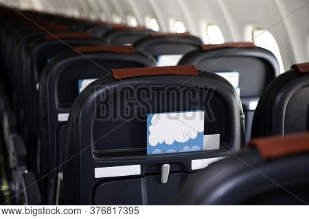 Airplane Instruction, Layout With Place For Text. Advertising Brochure. Empty Cabin Of The Plane. So