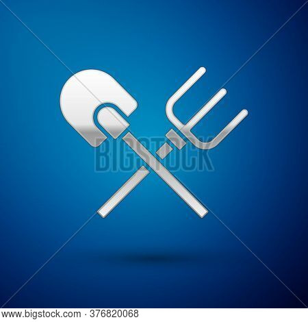 Silver Shovel And Rake Icon Isolated On Blue Background. Tool For Horticulture, Agriculture, Gardeni