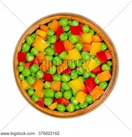 Green Peas And Diced Bell Peppers In Wooden Bowl. Mixed Vegetables. Seeds Of Pod Fruit Pisum Sativum