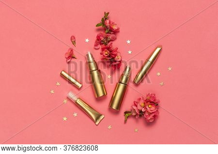 Cosmetics Branding Concept. Cosmetics, Spring Pink Flowers, Gold Stars Confetti On Pink Background.