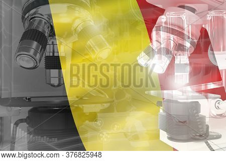 Microscope On Belgium Flag - Science Development Conceptual Background. Research In Biotechnology Or