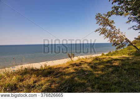View From The Escarpment To The Beach On The Baltic Sea On A Summer Day With People Resting
