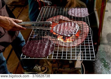 People Making Snacks Grill With Charcoal Stove Has A Name Called Puk, Which Sesame Rice Is A Meal Or
