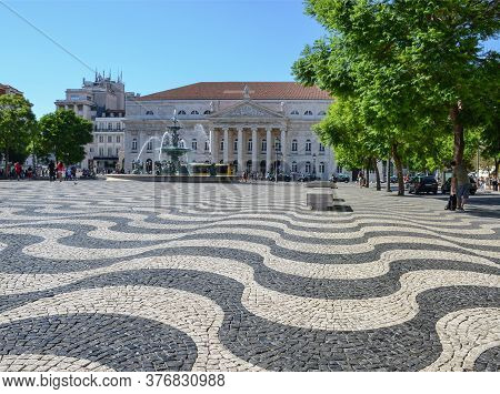 Rossio Square (or Pedro Iv Square) With Typical Portuguese Cobblestone Hand-made Mosaic Pavement And