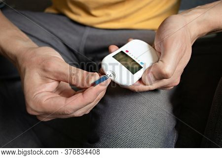 Close Up Man Checking Blood On Sugar Level. Home Medical Test. Concept Of Blood Sugar Level Testing.
