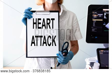 Medical Technology Concept. Words Heart Attack On The Board In The Doctor Hands. Ultrasound Medical