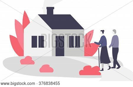 Senior Couple Walking To The House. Beautiful Small Cozy House And Elderly Man And Woman Walking On