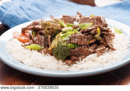 Ginger Beef Stir Fry Over White Rice And Vegetables