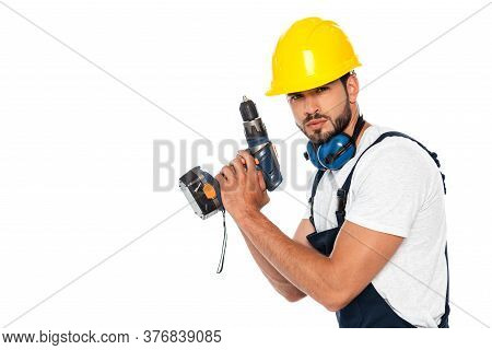 Handsome Workman In Hardhat And Ear Defenders Holding Electric Screwdriver Isolated On White