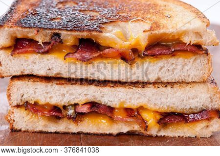 Decadent Grilled Cheese And Bacon Sandwiches With Oozing Cheese Running Out