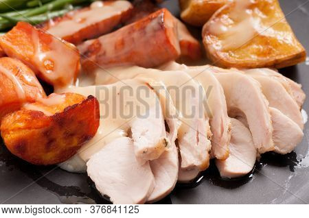 Traditional Turkey Dinner With Crispy Skin, Turkey Slices And Fresh Roasted Vegetables Smothered In