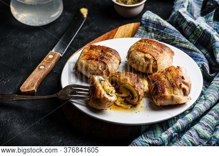Bacon-wrapped Button Mushrooms Stuffed With Grated Cheddar Cheese And