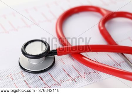 Medical Stethoscope Lies On Unilateral Cardiogram. Device With Function Temporary Monitoring Changes