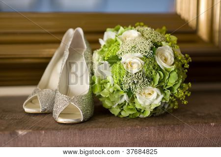 Wedding Shoes And Flowers Bouquet