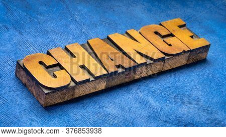 change - word abstract in vintage letterpress wood type, changing world concept