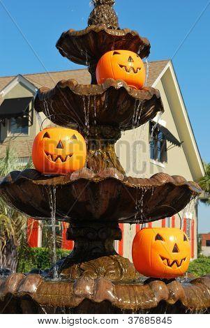 Three pumpkin pails in a fountain