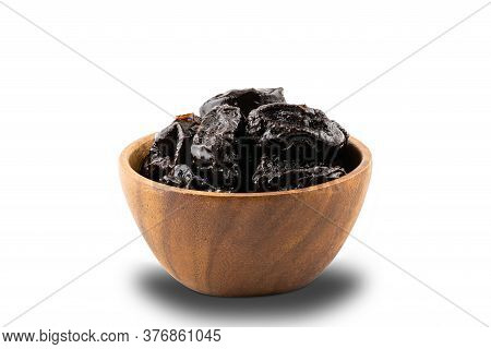Dried Pitted Prunes In Wooden Bowl On White Background With Clipping Path.