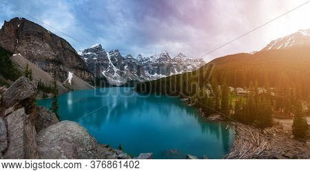 Beautiful Panoramic View Of An Iconic Famous Place, Moraine Lake, During A Vibrant And Colorful Suns