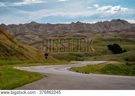 Winding Road Through The Badlands National Park Near Yellow Mounds Overlook