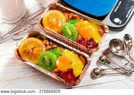Fruitcake In A Loaf Pan On A Wooden Table - Stock Photo