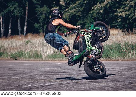Moscow, Russia - 17 Jul 2020: Moto Rider Making A Stunt On His Motorbike. Motorcyclist Making Wheeli