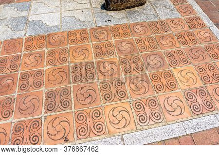 Symbol Of Shield Ornaments On The Footpath Tiles In Gimhae, South Gyeongsang Province, South Korea.