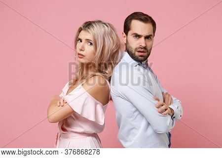 Perplexed Young Couple Two Guy Girl In Party Outfit Celebrating Posing Isolated On Pastel Pink Backg