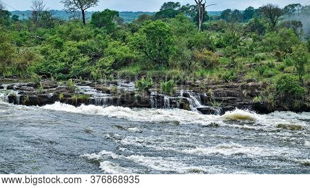 The Zambezi River Is Approaching Victoria Falls. Water Rushes In A Powerful Stream, Boils And Foams.