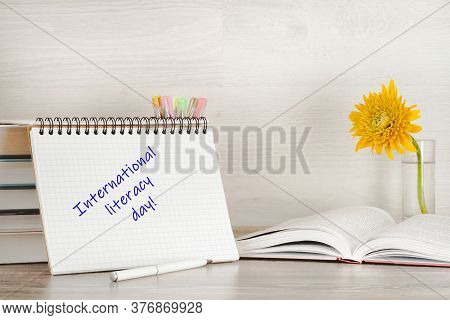 The Concept Of International Knowledge Day, Teacher's Day, And Education. On A Stack Of Books Is An