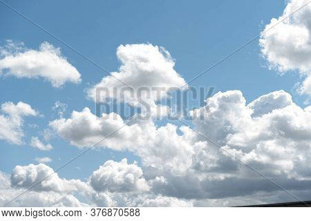 Clouds In The Sky. Blue Sky With Puffy White Summer Clouds