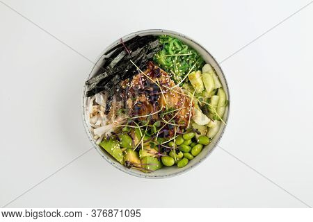 Top View On Unagi Poke Bowl With Green Beans Vegetables And Nori