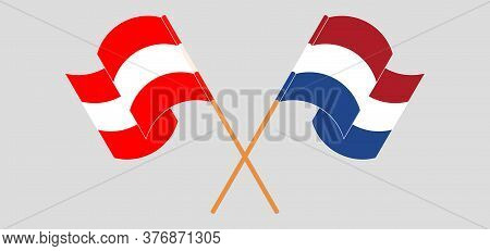 Crossed And Waving Flags Of Austria And The Netherlands. Vector Illustration