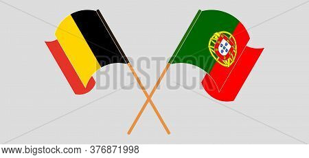 Crossed And Waving Flags Of Belgium And Portugal. Vector Illustration