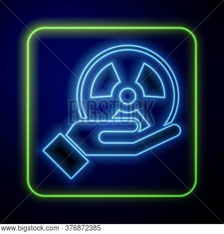 Glowing Neon Radioactive In Hand Icon Isolated On Blue Background. Radioactive Toxic Symbol. Radiati