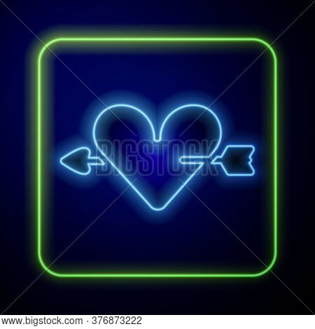 Glowing Neon Amour Symbol With Heart And Arrow Icon Isolated On Blue Background. Love Sign. Valentin