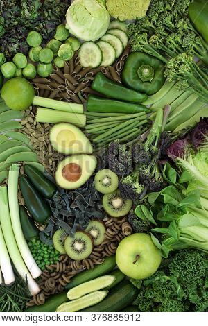 Low glycemic food for a healthy diabetic diet with plant based green vegetables & fruit high in vitamins, minerals, antioxidants, smart carbs & omega 3 fatty acids. Below 55 on the GI index. Top view.
