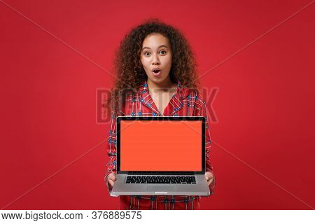 Shocked Young African American Girl In Pajamas Homewear Rest At Home Isolated On Red Background. Rel