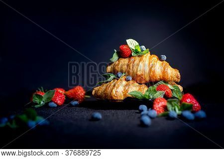 Croissants On A Dark Background. Croissant With Berries. French Breakfast With Croissants. Close Up.