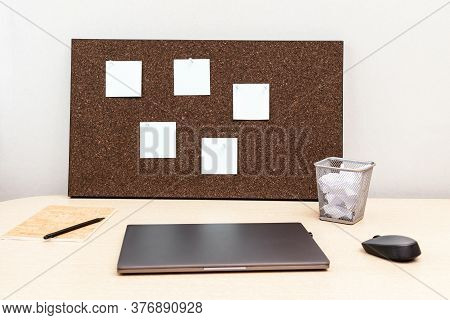 Working From Home. Laptop For Work And Wooden Bulletin Board With Empty Stickies. Workspace For Free